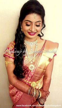 Prithvi is all smiles after her bridal makeover for her reception. Makeup and hairstyle by Swank Studio. Berry lips. Bridal hairstyle. Glitter eye makeup. Silk sari. Bridal Saree Blouse Design. Indian Bridal Makeup. Indian Bride. Gold Jewellery. Statement Blouse. Tamil bride. Telugu bride. Kannada bride. Hindu bride. Malayalee bride. Find us at https://www.facebook.com/SwankStudioBangalore