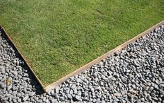 use 5mm non galvanised mild steel edging to contain lawn gravel areas and gardens from one another.  Within a couple of weeks the metal has reacted to the moisture in the atmosphere and turned a rust colour.   this style of edging is complimentary to both old and new houses