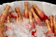 Pink mini bottles of champagne for the ladies