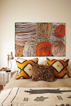 Orange accents with African influence. Tim Leveson bedroom