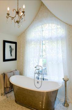 Gorgeous bathtub and chandelier!