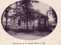 The old Methodist Episcopal (M. E.) Church was built in 1839, adjacent to Old Cemetery, which was established in 1829. Part of the cemetery is on the right. Samuel and Eliza Moore donated two lots on West Washington Street in Mooresville so that the M. E. Church and cemetery could be established there. It was used until 1882, when the M. E. Church moved to the corner of Harrison and  Indiana Streets (Photo by J. P. Calvert, who was choir director at the church for  40 years).