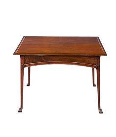 """Édouard Colonna (1862-1948) - Table. Carved Mahogany. Circa 1900. 28-1/4"""" x 36-3/4"""" x 22-1/2""""."""