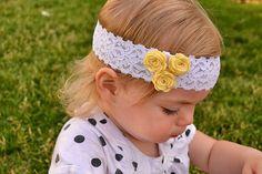Felt flower baby headband, available in three colors.