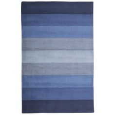 "Features:  -Cotton backing.  -Thickness: 0.5"".  Technique: -Tufted.  Primary Color: -Blue.  Type of Backing: -Cotton.  Material: -Wool/Cotton.  Product Care: -Spot clean with cool water. Professional"