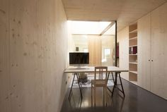 In the project the attic apartment of an apartment house was expanded by an additional room. The apartment is conformed over 2 floors. On the upper floor the...