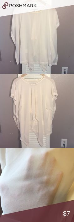 Forever 21 semi-sheer shirt Very pretty cream shirt. Don't know how to describe the back, but it looks really nice on. It's short at the mid back area with longer fabric at the side. Some of the stitching is pulling off. Look at pics. But besides that no stains or holes. Forever 21 Tops Tunics