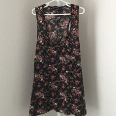 Floral tank top Black, thin tank top with a beautiful floral design. Has a functional left breast pocket. Runs on the small side. Spring is speeding around the corner and you know what's perfect for spring? Floral print Tops Tank Tops