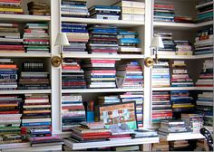Close-up of each section of bookcase with it's own pull-out shelf - love!