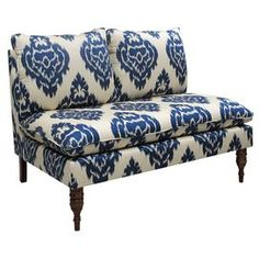 "Pine wood and foam settee with ikat-print upholstery. Handmade in the USA.   Product: Settee   Construction Material: Solid pine frame, polyurethane foam and polyester fill foam   Color: Blue   Features: Handmade in the USA   Dimensions: 35"" H x 49"" W x 35"" D    Cleaning and Care: Spot clean only"