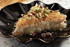 Kataifi Kiounefe (sweet cheese pie with shredded filo pastry) This very special dessert is best when served steaming hot topped with a heap of pistachio nuts! Greek Sweets, Greek Desserts, Greek Recipes, Turkish Baklava, My Favorite Food, Favorite Recipes, Greek Pastries, Greek Cheese, Filo Pastry