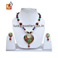 Planning to attend party but don't have funky #necklace set. Try this cool and funky Maroon Green Rajasthani Meenakari Designer Pendant set with Earring. Get it now online from #LuckyJewellery. This #monsoon season look stunning with this stylish necklace set. #jewelry #wedding #fashion #style #summer http://ift.tt/29o1nTz