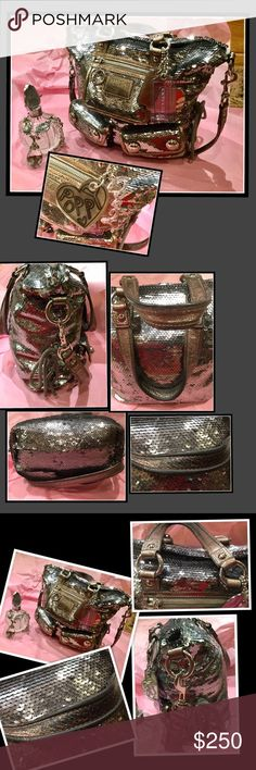 "Coach ""Poppy"" Limited Edition Silver Sequin Purse Authentic Coach, limited edition, from the newest Poppy line is a truly stunning, showstopper purse.  Features: exterior of Purse in very good condition. Sequins intact, leather handles have some patina. See pictures.  Lilac sateen lining has pen marks.  Nickel hardware, side cinch, zip top closure, exterior front zip pocket, lg inner zip pocket and 2 other pockets. Medium size purse.  No holds, trades,or off site deals. From smoke free home…"