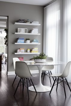 "More Eames! These are Eiffel dining chairs with a <a href=""http://www.knoll.com/product/saarinen-dining-table-42-round"" target=""_blank"">Saarinen table</a>."