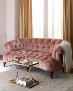 I have a longer tufted blush couch in my living room.... never regret that purchase...