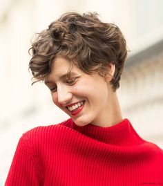 Short and curly hair, red lips, red sweater / Garance Doré