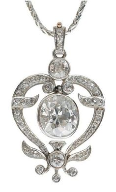 Late 19th/early 20th century, 3.14 cts. European-cut diamond set within open heart and foliate-shaped pendant, bead set on bail, forty-one single-cut diamonds, one bezel set European-cut diamond, estimated combined diamond weight 1.20 cts, platinum over 14 kt. yellow gold.: