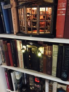 bookcase Love this look. Glow of warm cozy library.on a home library bookshel. bookcase Love this look. Glow of warm cozy library.on a home library bookshelf. Book Nooks, Reading Nooks, Fairy Houses, My House, House Floor, Book Art, Creations, House Design, Design Design