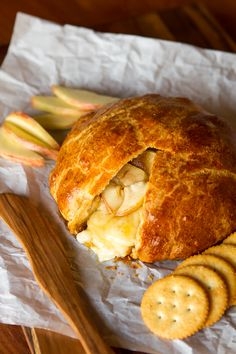 Baked Brie Appetizer -- this amazing baked Brie recipe features warm, melty Brie cheese, tender apples and sweet brown sugar, all wrapped up in buttery, delicious crescent dinner roll dough! | unsophisticook.com