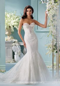 Strapless allover Chantilly lace over soft satin trumpet gown with re-embroidered hand beaded lace appliqués, sweetheart neckline, jewel encrusted beaded bodice also trims back neckline, horsehair hem, chapel length train, detachable spaghetti and halter straps included.