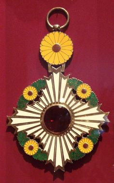 The Highest Order of the Chrysanthemum- Is the oldest of the Japanese orders. The badge of the order on a large ribbon was established by Emperor Meiji in 1876. the order's degree with the order chain was added on January 4, 1888. Although formally only has one degree, there are two types of orders: the order of the Chrysanthemum with a chain and the order of the Chrysanthemum with a large ribbon. Unlike European ones, posthumous awards are also possible for Japanese orders. Princess Victoria Of Sweden, Crown Princess Victoria, Yellow Chrysanthemum, Prince Frederik Of Denmark, Queen Margrethe Ii, Grand Cross, Imperial Japanese Navy, Royal Jewels, White Enamel