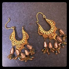 22K solid Gold earrings NWOT Beautiful solid 22K gold earrings NWOT. Reasonable offers welcome please respect when make offer. NO TRADES. Made in Pakistan. Jewelry Earrings
