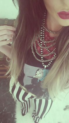 Navajo beads + western graphic tee + striped bell bottoms
