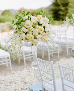 1) clear tall vases and 2) have ceremony aisle flowers double for reception center pieces - have guests mingle while reception is finalized