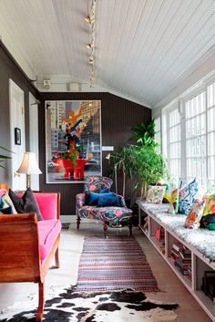 This living space makes great use of color and textiles. We also love how it has subtle pops of color and patterns! So cute!