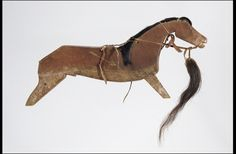 Assiniboine horse stick. Made by Medicine Bear, circa 1860. Song for the Horse Nation Spotlight: Ceremonial Objects and Honoring the Horse .The famous warrior and diplomat Medicine Bear carved the likeness above in memory of his war pony, killed in battle in norther Montana in the mid-1800s; the mane and tail on this dance stick came from that pony.