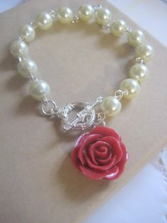 Ivory glass pearl red rose bracelet. Other pearl, rose colours available.. $15.00, via Etsy.