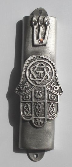 This beautiful pewter Chamsa Mezuzah is approximately 3 1/4 inches tall. The inside cavity is approximately 3 inches long. The shin is adorned with 3 Swarovski rhinestones. Please see our other styles
