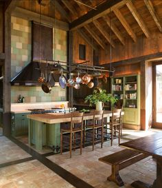 Hanging kitchen utensils above the counter adds creative storage space and draws attention to beautiful vaulted ceilings.