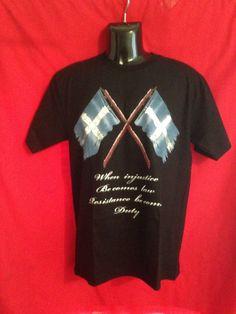 EUREKA-Stockade Flag on front of a black-cotton short-sleeve t-shirt X Big Tees