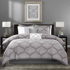 The Madison Park Vella Comforter Set uses a woven jacquard fabrication to create a unique ogee design. The charcoal grey background provides the perfect base for the silver faux sequin motif.