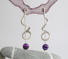 Silver dangle earring with purple agate - They have a great movement, comfartable for everyday wear.  via Etsy.