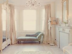 White Dressing Area / Ornate White Mirrored Armoire / White Fireplace / Chaise Lounge / Crystal Chandelier
