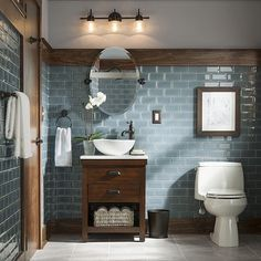Make an impression in your guest bathroom with warm wood tones. Click the link…