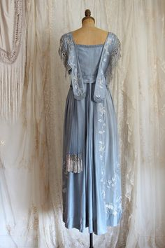 1910S TITANIC ERA EVENING GOWN Authentic Antique 1910s Edwardian Titanic-Era evening gown! I have seen so many wonderful pieces in my 30 + years of collecting and I have to say this has got to be one of best antique dresses I have ever had the privilege of caring for. When I first received this beauty I thought for sure it must be a reproduction, but this is the real deal. Truly a work of art. The materials and craftsmanship are superb with every attention to detail. Hand stitching…