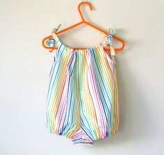 Baby girls rainbow bubble rompers - a perfect baby shower gift or cake smash outfit. These rainbow striped rompers will bring a smile to everyone