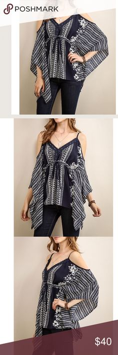"""Buy 1 Get 1 50%Gorgeous Kimono Cold Shoulder Top Gorgeous Top!! Incredibly high quality kimono navy print top. Lace Embroidered V neck design. Adjustable shoulder strap's with drawstring waist. Dry Clean only. 94% Polyester 4% Spandex. Very Flattering!! Eye catching from every angle!! Price firm unless bundled. Large Bust Measured Laying Flat expands to 25"""" White Box Boutique Tops Blouses"""