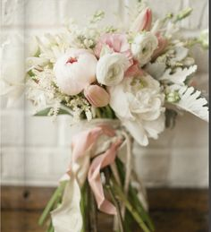 pretty in pink - peonies, tulips, ranunculus, astilbe, dusty miller, agapanthus // bridesmaid bouquets