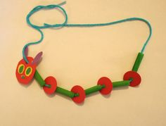 Eric Carle - Very Hungry Caterpillar necklace craft - green-dyed pasta, yarn, paper scraps. Kinder orientation for next year? Eric Carle, Book Crafts, Arts And Crafts, Art Crafts, Hungry Caterpillar Craft, Counting Caterpillar, Caterpillar Book, Spring Crafts For Kids, Classroom Crafts