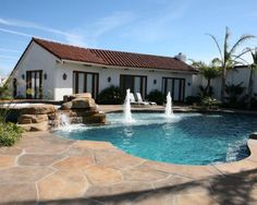 , Captivating Traditional Pool With Stamped Concrete Pool Deck Also Adorable Pol Design Also Modern House Design With White Wall Paint Color And Cool Exterior Wall Lights: Stamped Concrete Patios with Beautiful Rocks