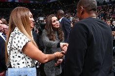 Prince William and Catherine, Duchess of Cambridge, aka Kate Middleton, meeting Beyoncé and Jay-Z at a Nets game in Brooklyn, NY. Kate is wearing the Bettina coat by Tory Burch, black J. Crew jeans, her Mulberry clutch, her Stuart Weitzman 'Power' pumps, and Patrick Mavros Crocodile Stud earrings. 12/08/14