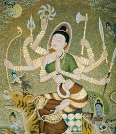 Parvati embodied as Mother Goddess Durga with great powers and divine grace. She holds a rosary in her right hand and a water utensil in her left.  She is blissful and endows happiness, she is the way to emancipation - moksha.