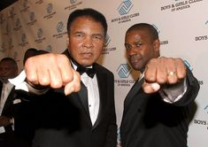 """Denzel Washington and Muhammad Ail share a special """"iconic"""" moment during Muhammed Ali's 70th birthday celebration (2012)."""