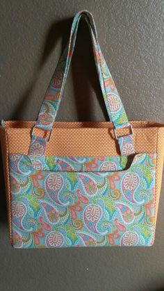 Conference tote bag made from so-sew-easy pattern. Easy instructions to follow & fun to make. Fabrics from hobby lobby. Orange is my favorite color.