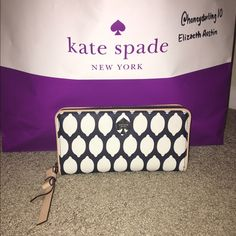 Kate Spade Grant Street Neda This is an authentic Kate spade Grant Street grainy vinyl neda wallet. This while it has only been used two times. No outside scratches or marks, and no visible marks on the inside. kate spade Bags Wallets