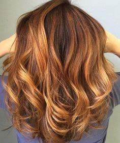 Another beautiful summer style, a chocolate brown into a bronze copper ombre with a slight curl to the ends.